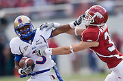 FAYETTEVILLE, AR - NOVEMBER 1:   Damaris Johnson #3 of the Tulsa Golden Hurricanes stiff arms Matt Harris #39 of the Arkansas Razorbacks at Donald W. Reynolds Stadium on November 1, 2008 in Fayetteville, Arkansas.  The Razorbacks defeated the Golden Hurricanes 30 to 23.  (Photo by Wesley Hitt/Getty Images) *** Local Caption *** Damaris JohnsonUniversity of Arkansas Razorback Men's and Women's athletes action photos during the 2008-2009 season in Fayetteville, Arkansas....©Wesley Hitt.All Rights Reserved.501-258-0920.