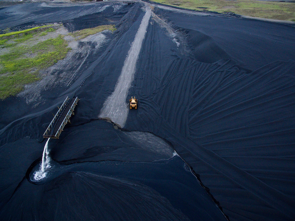 Canada, Manitoba, Aerial view of vast field of black slag surrounding Vale Inco Manitoba nickel smelter and mine