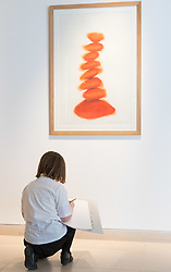 "Christies, St James, London, March 4th 2016. Nine year-old Ashley Hubbard from Charlton Manor Primary School does a drawing on David Nash's ""Column"", created especially for the auction at the preview for the It's Our World charity auction at Christie's. Over 40 leading artists including David Hockney, Sir Antony Gormley, David Nash, Sir Peter Blake, Yinka Shonibare, Sir Quentin Blake, Emily Young and Maggi Hambling have committed artworks to the It's Our World Auction in support of The Big Draw and Jupiter Artland Foundation, to be sold at Christie's London on 10 March 2016.<br />  ///FOR LICENCING CONTACT: paul@pauldaveycreative.co.uk TEL:+44 (0) 7966 016 296 or +44 (0) 20 8969 6875. ©2015 Paul R Davey. All rights reserved."