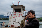 Passengers ride a ferry boat in Xishuangbanna prefecture, China.