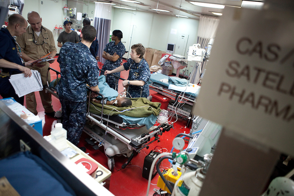 The second victim of the earthquake in Haiti, a six year old boy being treated for a fractured pelvis, is tended to in the casualty receiving area of the USNS Comfort, a naval hospital ship, after being flown by helicopter from the USS Vinson on Wednesday, January 20, 2010 in the Atlantic ocean near Port-Au-Prince, Haiti. The boy arrived unaccompanied and does not know where his parents are, but was able to give a cell phone number. The Comfort deployed from Baltimore, bringing nearly a thousand medical personnel to care for victims of Haiti's recent earthquake, and is expected to arrive off the coast of Port-Au-Prince on Wednesday.