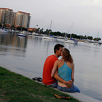 ST. PETERSBURG, FL -- June 29, 2008 -- James Hubbell and Jaclynne Smith, both of St. Petersburg, share a kiss as they look out over Tampa Bay in downtown St. Petersburg, Fla., on Sunday, June 29, 2008.  St. Petersburg's downtown is thriving with new shops, restaurants, and bars that are feeding off a younger, energetic crowd that fills its walkable map pinpointed with rejuvenated historic hotels and condos.