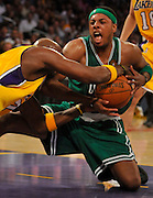 Lakers Lamar Odom reaches in to tie up Celtics Paul Peirce in the 2nd quarter. The Lakers defeated the Boston Celtics in game 6 of the NBA Finals 89-67. Los Angeles, CA 06/15/2010 (John McCoy/Staff Photographer).