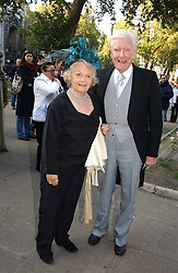 MR & MRS PAUL JOHNSON at the wedding of Clementine Hambro to Orlando Fraser at St.Margarets Westminster Abbey, London on 3rd November 2006.<br />