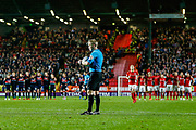 PENALTIES Referee Gavin Ward looks at his notebook before the start of penalties after the EFL Sky Bet League 1 second leg Play-Off match between Charlton Athletic and Doncaster Rovers at The Valley, London, England on 17 May 2019.