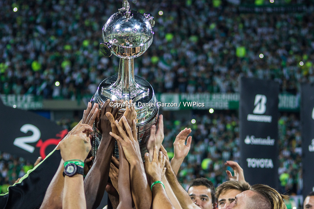Players of Atletico Nacional lift the trophy after a second leg final match between Atletico Nacional and Independiente del Valle of Ecuador