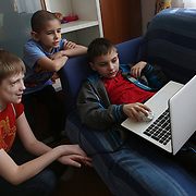 Because of his illness Kirill cannot go to school so he spends a lot of time in front of a computer playing games with his new friends.