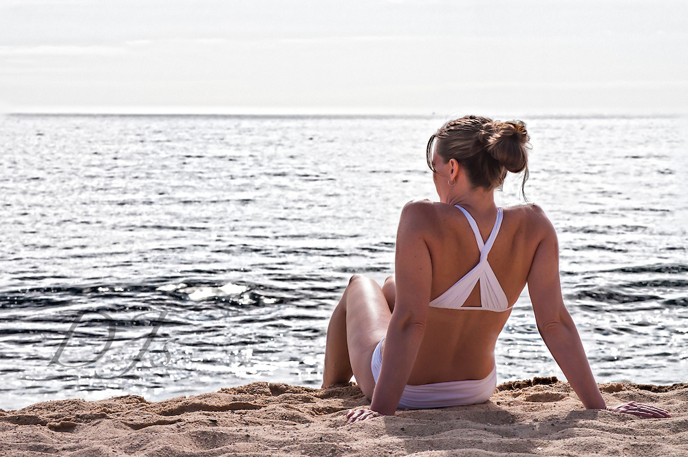 Beautiful woman relaxing at the beach