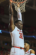 LUBBOCK, TX - MARCH 3: Norense Odiase #32 of the Texas Tech Red Raiders hangs from the rim during the game against the TCU Horned Frogs on March 3, 2018 at United Supermarket Arena in Lubbock, Texas. Texas Tech defeated TCU 79-75. Texas Tech defeated TCU 79-75. (Photo by John Weast/Getty Images) *** Local Caption *** Norense Odiase