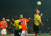 Photo: Richard Lane/Richard Lane Photography. Watford v Blackpool. Coca Cola Championship. 01/11/2008. John Eustace (R) gets to the ball with Ben Burgess (C) and Lloyd Doyley (L) close by