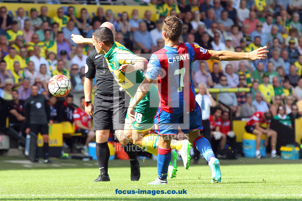 Graham Dorrans of Norwich is fouled by Yohan Cabaye of Crystal Palace during the Barclays Premier League match at Carrow Road, Norwich<br /> Picture by Paul Chesterton/Focus Images Ltd +44 7904 640267<br /> 08/08/2015