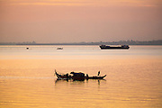 29 JUNE 2013 - PHNOM PENH, CAMBODIA:   Fishing boats on the Tonle Sap River in Phnom Penh, Cambodia.    PHOTO BY JACK KURTZ