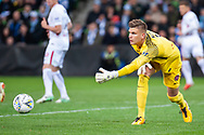 Western Sydney Wanderers goalkeeper Daniel Nizic (1) passes on the ball at the FFA Cup quarter-final soccer match between Melbourne City FC and Western Sydney Wanderers FC at AAMI Park in Melbourne.