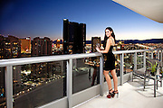 Sexy Female On Balcony Overlooking The City