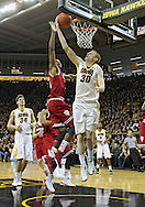 December 31 2012: Iowa Hawkeyes forward Aaron White (30) puts up a layup as Indiana Hoosiers forward Jeremy Hollowell (33) tries to block it during the first half of the NCAA basketball game between the Indiana Hoosiers and the Iowa Hawkeyes at Carver-Hawkeye Arena in Iowa City, Iowa on Monday December 31, 2012. Indiana defeated Iowa 69-65.