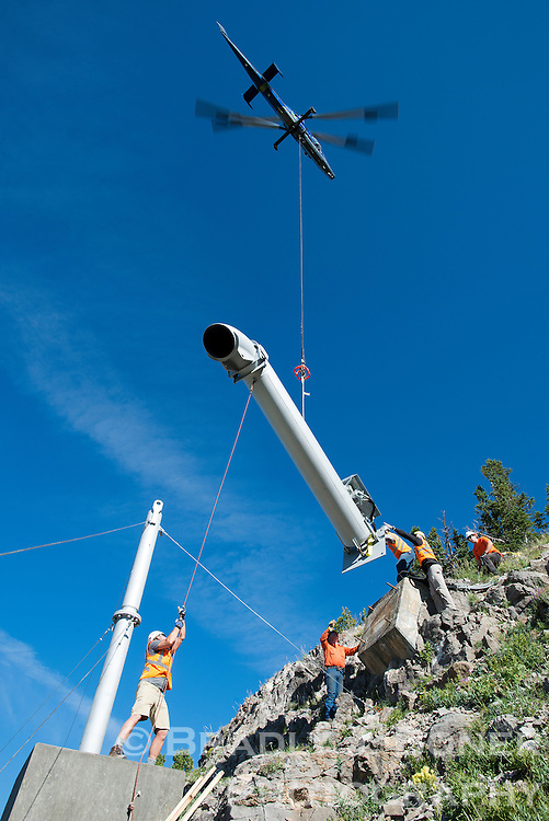 A helicopter lowers an Gazex exploder tube to Wyoming Department of Transportation workers on Tuesday in Twin Slides on Mount Glory. The new Gazex, and another in adjacent Glory Bowl, replaces an aging model as part of upgrades to WYDOT's avalanche control system on Teton Pass.