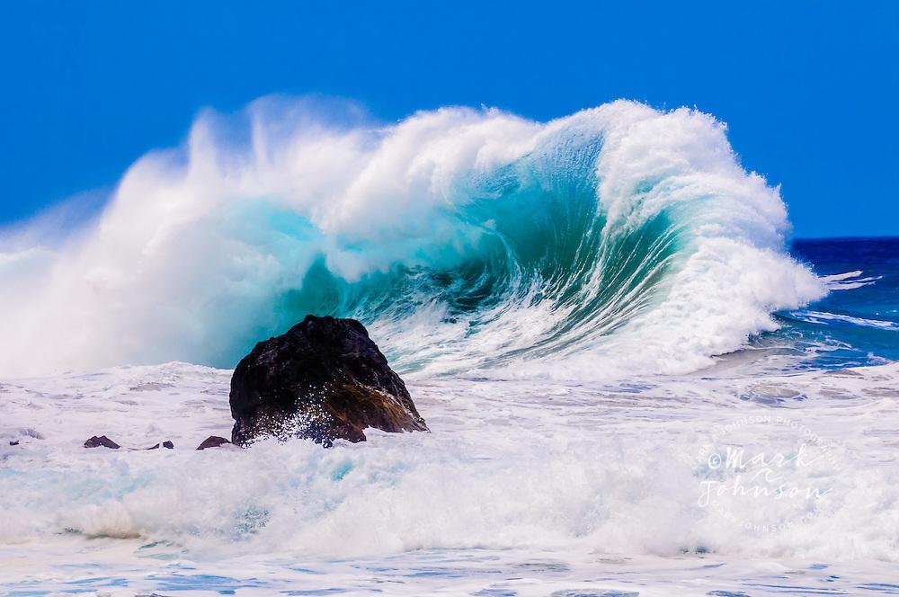 Kauai, Hawaii, USA --- Giant wave breaking off the Na Pali Coast of Kauai, Hawaii, USA
