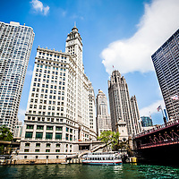 Downtown Chicago buildings picture. Photo includes Michigan Avenue Bridge (DuSable Bridge), the Chicago River, Wrigley Building, Tribune Tower, and The Equitable Building.