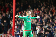 Brentford goalkeeper David Button celebrating Brentford first goal to make score 1-0 during the Sky Bet Championship match between Brentford and Huddersfield Town at Griffin Park, London, England on 19 December 2015. Photo by Matthew Redman.