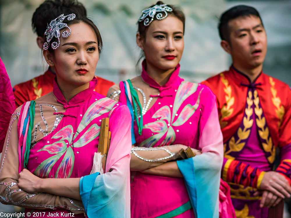 25 JANUARY 2017 - BANGKOK, THAILAND:        Chinese dancers wait to go on stage during Chinese New Year, also called Tet, celebrations in Lumpini Park in Bangkok. 2017 is the Year of the Rooster in the Chinese zodiac. This year's Lunar New Year festivities in Bangkok were toned down because many people are still mourning the death Bhumibol Adulyadej, the Late King of Thailand, who died on Oct 13, 2016. PHOTO BY JACK KURTZ
