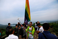 LGBT (lesbian, gay, bisexual and transgender) members tour Saikai National Park during a stopover of a cruise organised by the Parents and Friends of Lesbians and Gays (PFLAG) China organisation at Sasebo, Nagasaki, Japan, 16 June 2017. About 800 members of the Chinese LGBT (lesbian, gay, bisexual and transgender) community and their parents spent four days on a cruise trip organised by Parents and Friends of Lesbians and Gays (PFLAG) China, a grassroots non-government organisation, celebrating the 10th anniversary of the organisation. It aims to promote coexistence among homosexuals and their families.