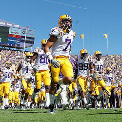October 1, 2011; Baton Rouge, LA, USA;  LSU Tigers cornerback Tyrann Mathieu (7) leads his teammates onto the field prior to kickoff of a game against the Kentucky Wildcats at Tiger Stadium.  Mandatory Credit: Derick E. Hingle-US PRESSWIRE / © Derick E. Hingle 2011