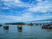 23 AUGUST 2018 - TELUK BAHANG, PENANG, MALAYSIA: Tourist boats and commercial fishing trawlers in port in Teluk Bahang, on the island of Penang, sorts lines used to drag nets. Fishermen on Penang, an island off the west coast of mainland Malaysia, are being pressured by the island's resort development and reduce catches in the waters off Malaysia.     PHOTO BY JACK KURTZ