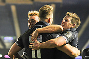 Duhan van der Merwe is congratulated by team mates on scoring try during the Guinness Pro 14 2018_19 match between Edinburgh Rugby and Dragons Rugby at Murrayfield Stadium, Edinburgh, Scotland on 15 February 2019.