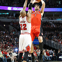 24 March 2012: Toronto Raptors center Andrea Bargnani (7) takes a jumpshot over Chicago Bulls forward Taj Gibson (22) during the Chicago Bulls 102-101 victory in overtime over the Toronto Raptors at the United Center, Chicago, Illinois, USA.