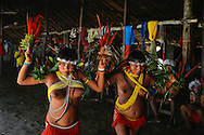 Welcoming party. With feathers of Arara (perrots) young girls dance to present themselves to the village and guests.
