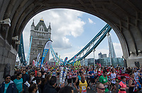 Mass of runners pass by Tower Bridge The Virgin Money London Marathon 23rd April 2017 <br /> <br /> For more information please contact media@londonmarathonevents.co.uk<br /> <br /> Picture by Bob Martin for Virgin Media London Marathon