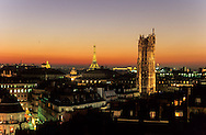 France. Paris. elevated view. Saint Jacques tower. the eiffel tower and panoramic view  view from the dome of the bazar de l'hotel de ville       The Eiffel Tower and Tour St.-Jacques stand illuminated against a colorful sky at twilight in Paris. Tour St.-Jacques was once the tower of the Boucherie church.