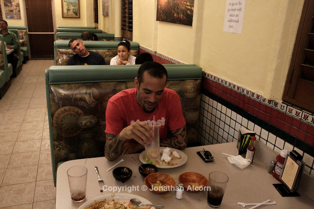 Ben Harper eats at a mexican restaurant he's been going to for years in Pomona, California, U.S. December 8, 2012 ©Jonathan Alcorn/JTA.