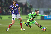 Forest Green Rovers Luke James(33) is brought down by Exeter City's Dean Moxey(21) during the The FA Cup match between Forest Green Rovers and Exeter City at the New Lawn, Forest Green, United Kingdom on 2 December 2017. Photo by Shane Healey.