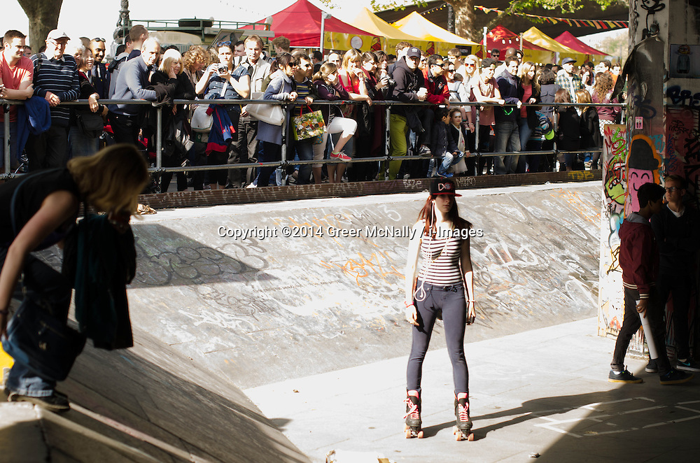 A girl roller skates in front of the crowds on the Southbank, where all wheels were accepted at the Long Live Southbank bank holiday celebration