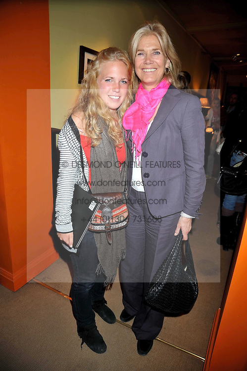 Left to right, CHRISTABEL BEESON and her mother CARRIE BEESON at a party to celebrate the publication of Joth Shakerley's book 'Pregnant Women' held at 598a Kings Road, London SW6 on 20th May 2009.
