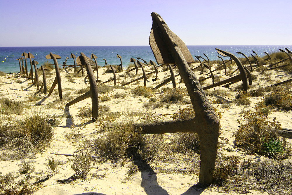 The cemetery of anchors on the beach at Praia Do Barril near Tavira, Faro, Portugal.<br /> Each anchor is to represent a tuna ship lost in the Atlantic.