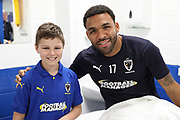 AFC Wimbledon striker Andy Barcham (17) and mascot during the EFL Sky Bet League 1 match between AFC Wimbledon and Oxford United at the Cherry Red Records Stadium, Kingston, England on 29 September 2018.
