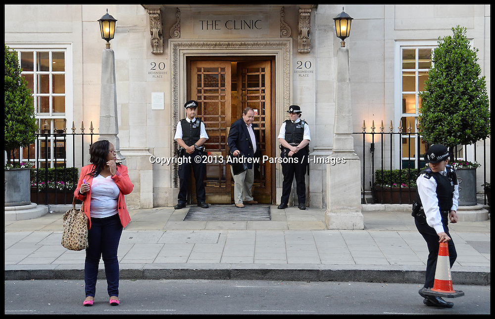 Police Officers stand outside The London Clinic Hospital.  The Duke of Edinburgh has been admitted to the Hospital for exploratory operation following abdominal investigations, Thursday, 6th June 2013,Picture by Andrew Parsons / i-Images