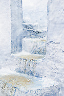 Old, white, blue stone staircase in the medina of Chefchaouen, Morocco.