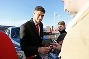 Middlesbrough forward Rudy Gestede (39) signing autographs during the EFL Sky Bet Championship match between Middlesbrough and Ipswich Town at the Riverside Stadium, Middlesbrough, England on 29 December 2018.