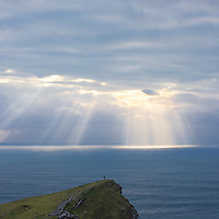 Mystical Sunbeam with Person standing on Bray Head Cliffs, Valentia Island, Ring of Kerry, Ireland / hn001