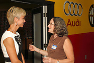 Lori Firsdon of Forte Organizers (left) and Bethany Schumacher of Konicki Schumacher Chiropractic during a Women in Business Networking After 5 event at Audio Etc. in Centerville, Thursday, August 30, 2012.