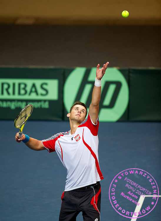 Maciej Smola of Poland competes at man's singles match at third day during the BNP Paribas Davis Cup 2012 between Poland and Belarus at MOSiR Hall in Lodz on September 16, 2012...Poland, Lodz, September 16, 2012..Picture also available in RAW (NEF) or TIFF format on special request...For editorial use only. Any commercial or promotional use requires permission...Photo by © Adam Nurkiewicz / Mediasport