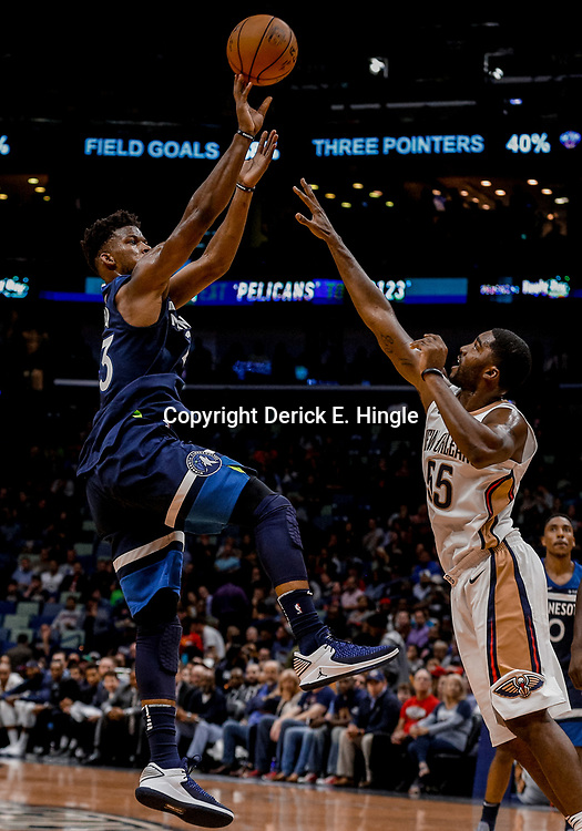 Nov 1, 2017; New Orleans, LA, USA; Minnesota Timberwolves guard Jimmy Butler (23) shoots over New Orleans Pelicans guard E'Twaun Moore (55) during the second quarter of a game at the Smoothie King Center. Mandatory Credit: Derick E. Hingle-USA TODAY Sports