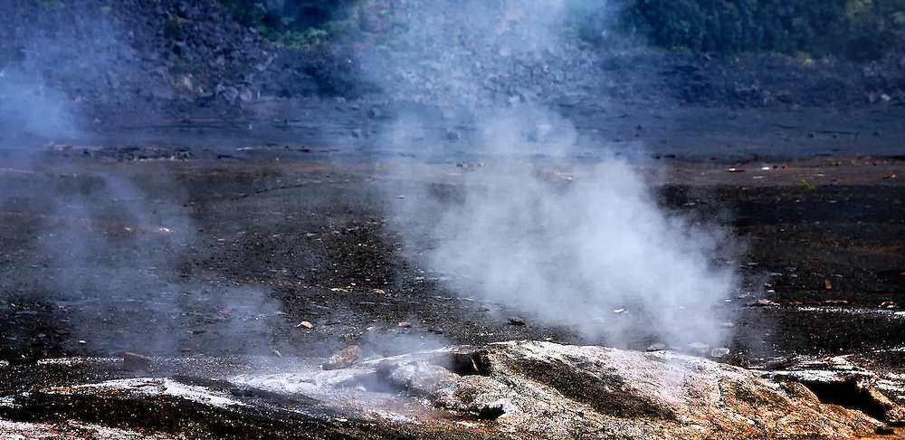 Sulfur dioxide gases rise from below the earth's surface into the air at a crater in Hawaii Volcanoes National Park, island of Hawaii.