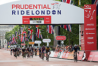 First riders cross the line after completing the London-Surrey 100 at Prudential Ride London on Sunday 30th July 2017<br /> <br /> Photo: Paul Gregory/Silverhub for Prudential RideLondon<br /> <br /> Prudential RideLondon is the world's greatest festival of cycling, involving 100,000+ cyclists – from Olympic champions to a free family fun ride - riding in events over closed roads in London and Surrey over the weekend of 28th to 30th July 2017. <br /> <br /> See www.PrudentialRideLondon.co.uk for more.<br /> <br /> For further information: media@londonmarathonevents.co.uk