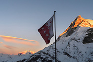 The Monte Rosa and the west face of the Matterhorn and the star flag from the Schönbielhütte in the last light, Valais, Switzerland