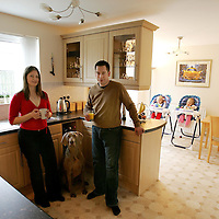'Right At Home' property feature..25.03.07<br />Paul & Jenny Murray's home at 51 Petrel Way, Dunfermline.<br />In the kitchen and dining area with dog Holly and twins Carrie (left and Leah<br />Picture by Graeme Hart.<br />Copyright Perthshire Picture Agency<br />Tel: 01738 623350  Mobile: 07990 594431
