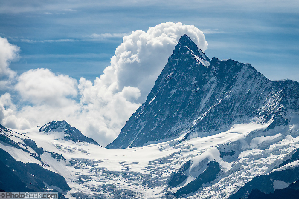 The Finsteraarhorn (4274 m / 14,022 ft) is the highest mountain in the Bernese Alps and the most prominent peak of Switzerland (in terms of the lowest topographic contour at the mountain's base). Hike a spectacular trail from Eigeralp farm at upper Bussalp, around Faulhorn to Bachalpsee, finishing at the gondola lift station at First, which descends to Grindelwald BGF. Grindelwald is in the canton of Bern, Switzerland, the Alps, Europe. The Swiss Alps Jungfrau-Aletsch region is honored as a UNESCO World Heritage Site.